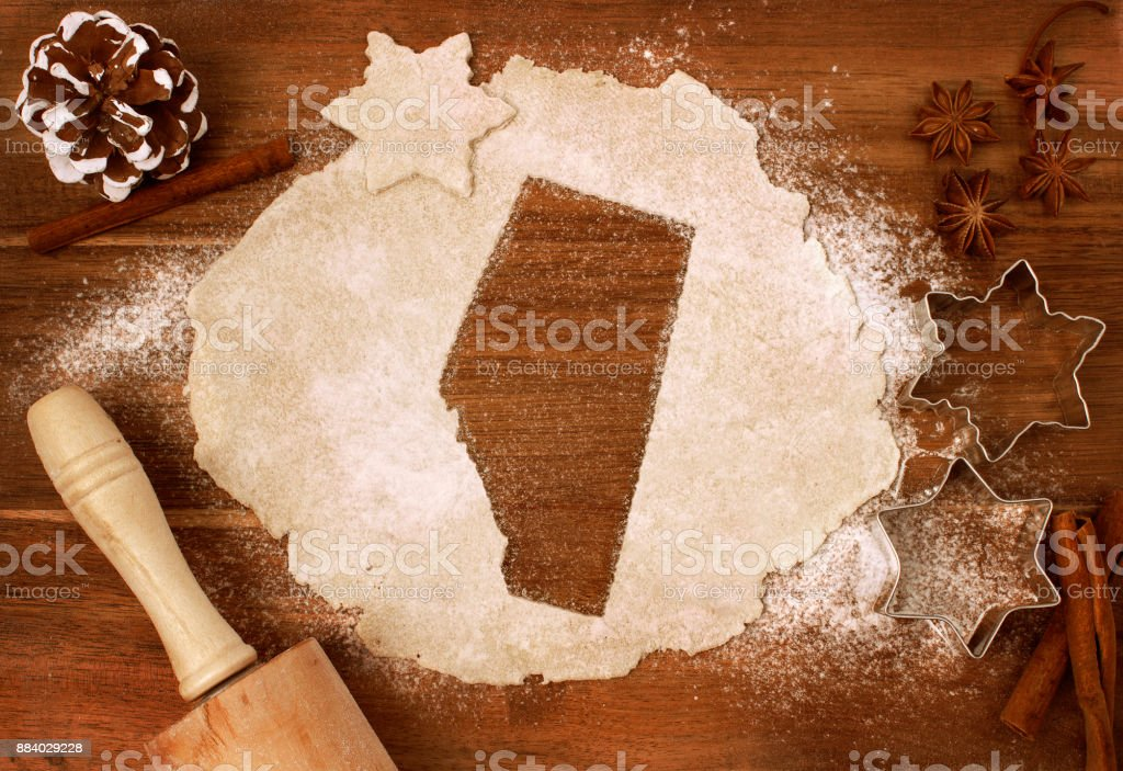 Cookie dough cut as the shape of Alberta (series) stock photo