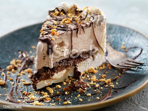 Cookie Dough Ice Cream Cake with Chocolate Sauce and Crushed Almonds