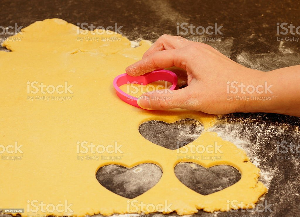 Cookie dough with heart pastry cutter stock photo