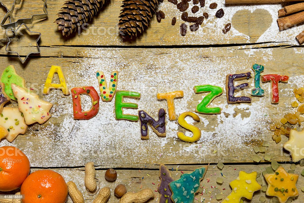 Cookie letters with christmas decoration on wood, german word 스톡 사진