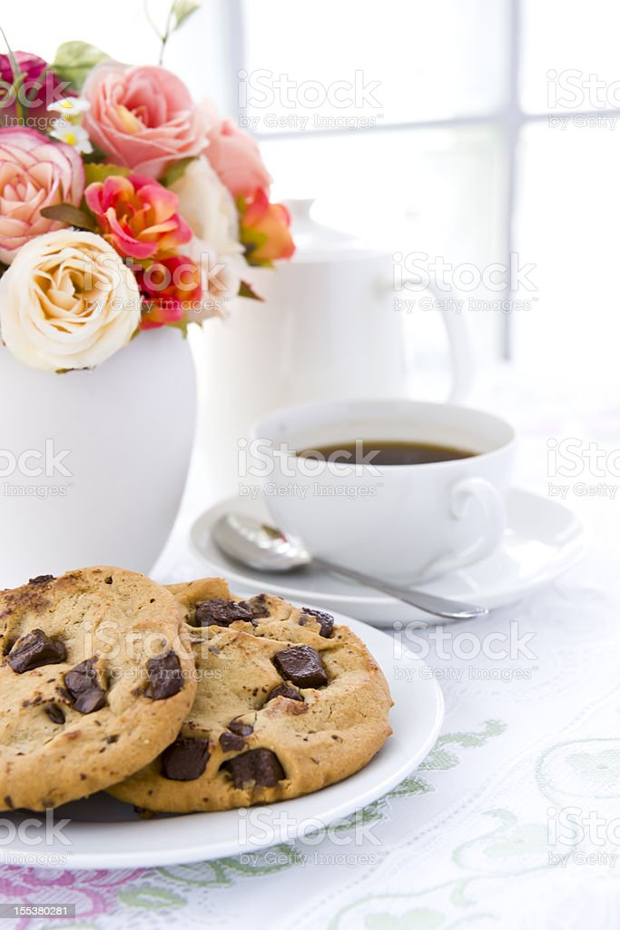 Cookie  on white plate with black coffee and flower royalty-free stock photo