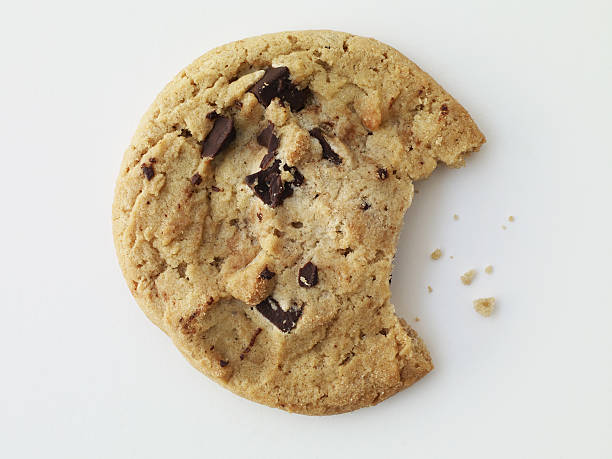 Cookie Chocolate chip cookie with a bite taken out-clipping path included chocolate chip cookie stock pictures, royalty-free photos & images