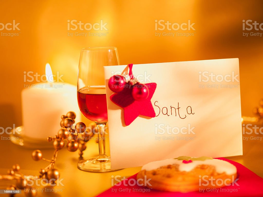 Cookie, wine and card for Santa royalty-free stock photo