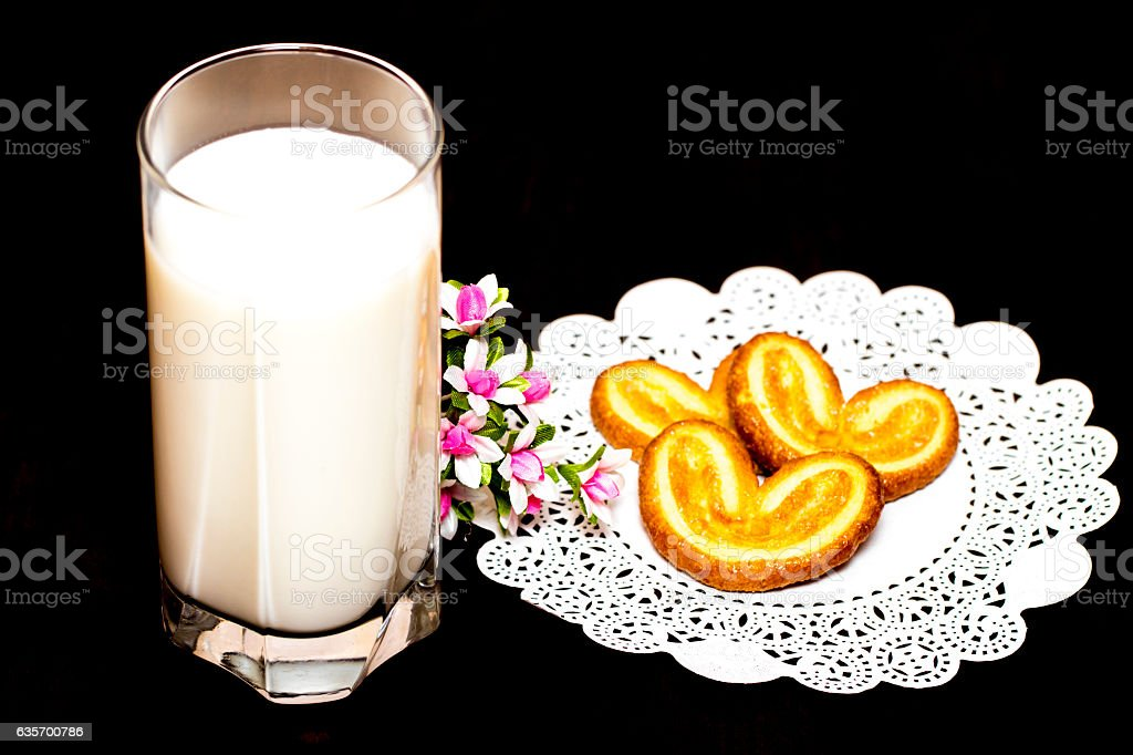 Cookies and a glass of milk - healthy breakfast. Wooden royalty-free stock photo