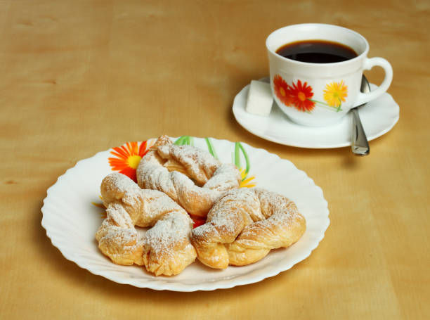 Cookies and a hot Cup of coffee with sugar. stock photo