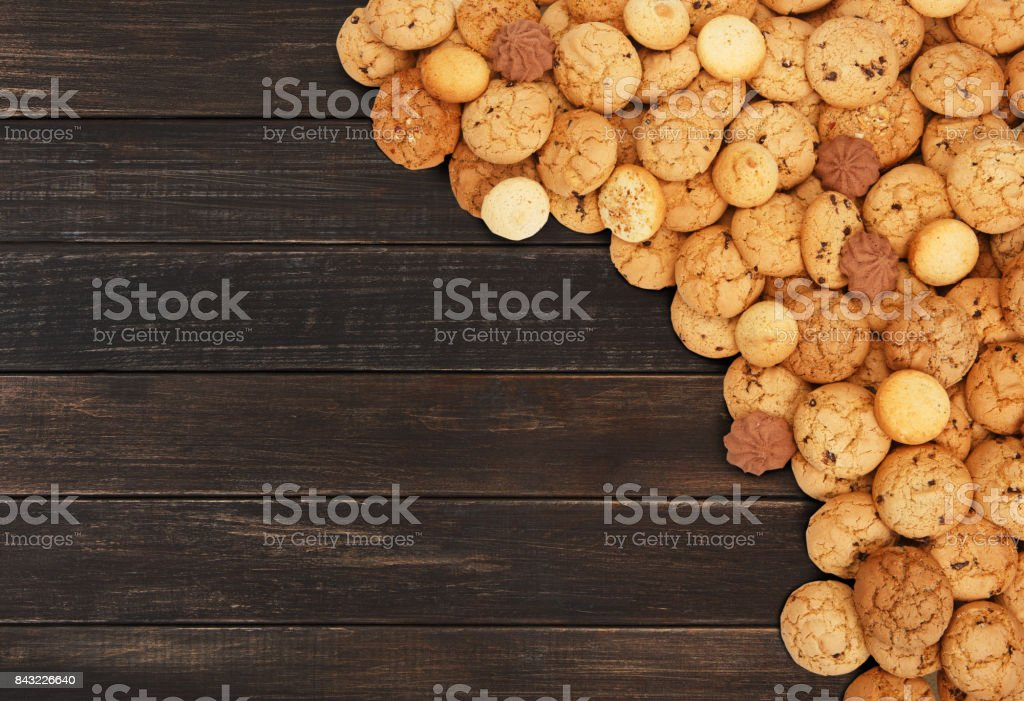 Cookies and biscuits at brown wood with copy space stock photo