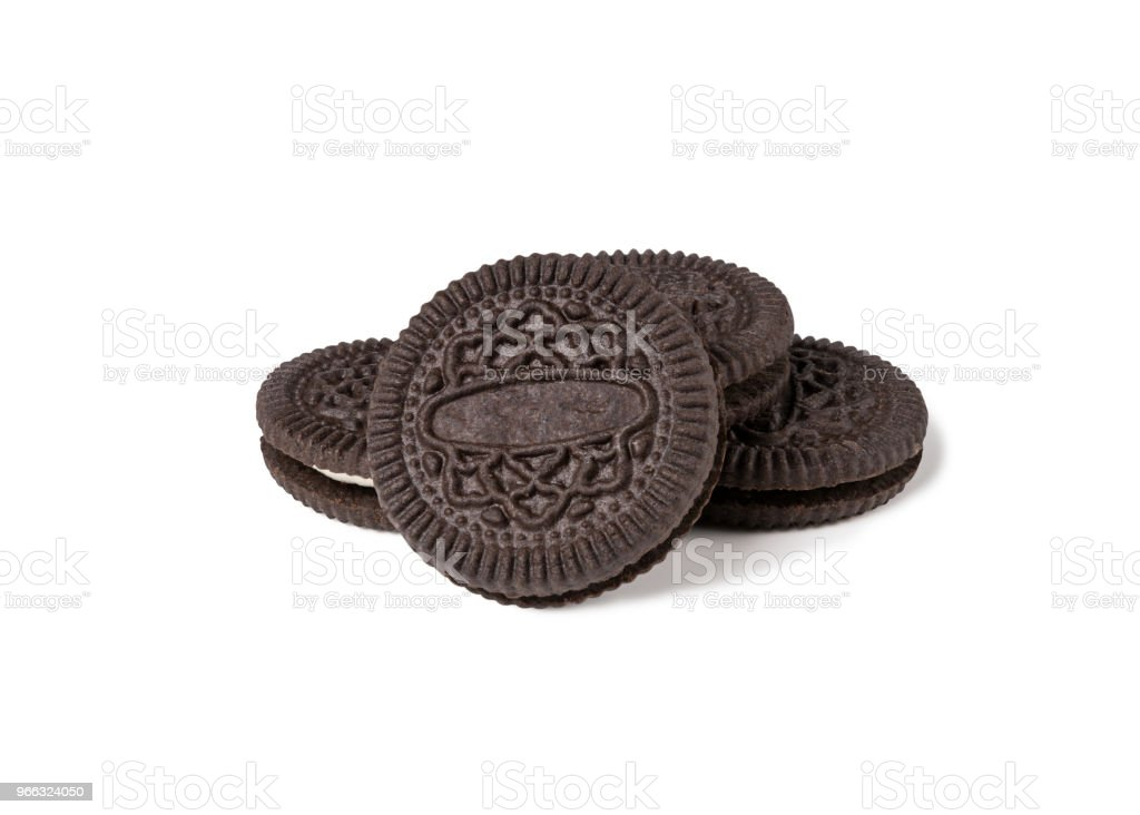 Cookies and cream of chocolate flavour in pieces of outside crust isolated on white background (Clipping Path included), american style snack stock photo