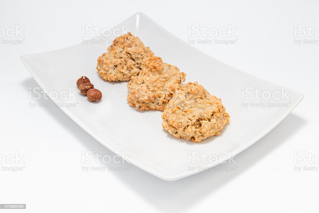 Cookies 'brutti ma buoni'  - three cookies on the plate. stock photo
