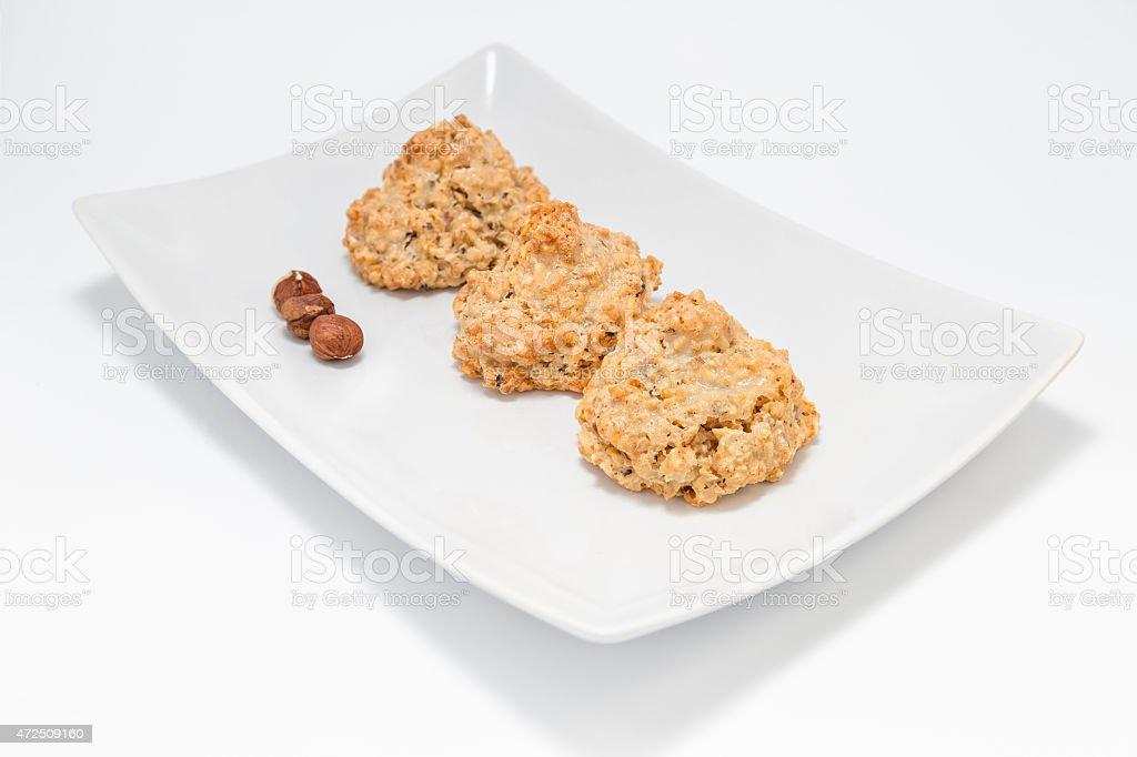 Cookies 'brutti ma buoni'  - three cookies on the plate. stock photo