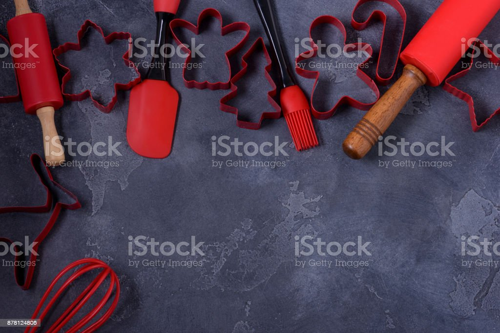 Cookies cutters and kitchen utensils stock photo