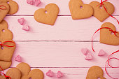 cookies heart on pink wooden background