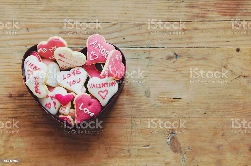 Cookies in a box for Valentine's day on wooden table stock photo