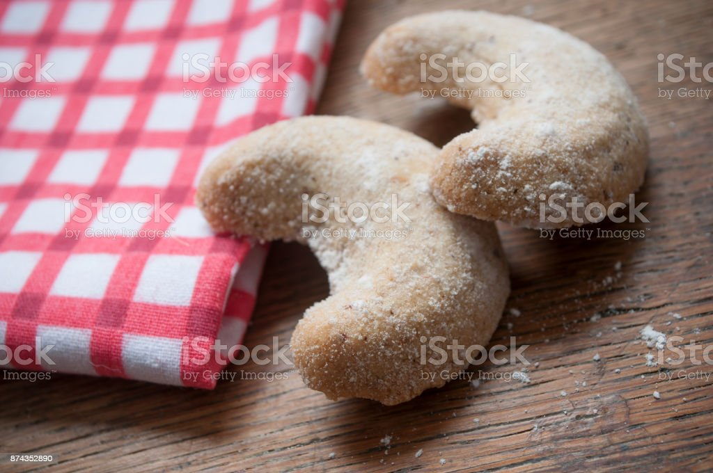 cookies in the shape of a crescent moon on wooden background stock photo