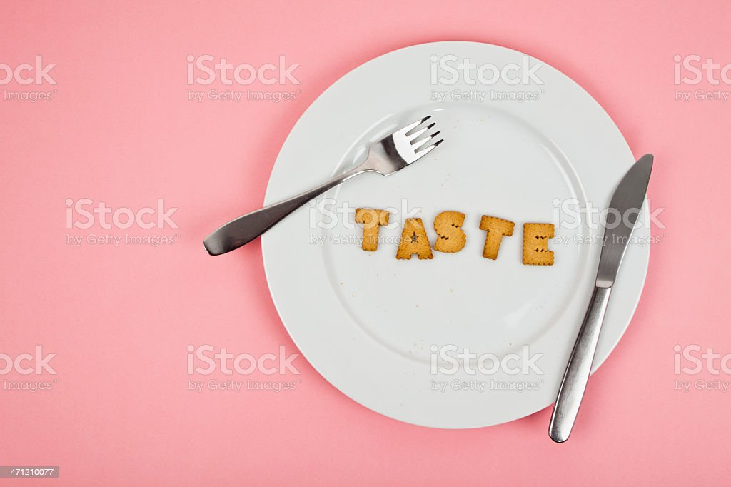 Cookies in the shape of the word taste royalty-free stock photo
