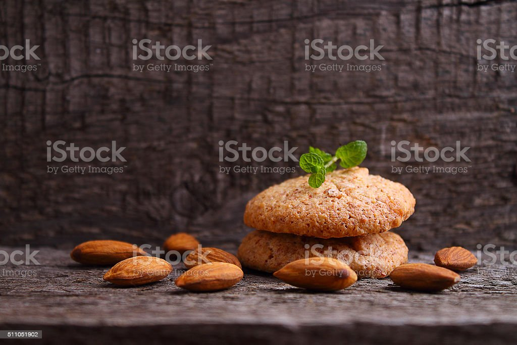 cookies on a dark background with almonds stock photo