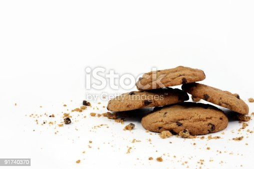 Cookies stacked up with crumbs around them