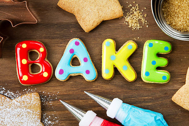 Cookies spelling bake Cookies forming the word bake icing bag stock pictures, royalty-free photos & images