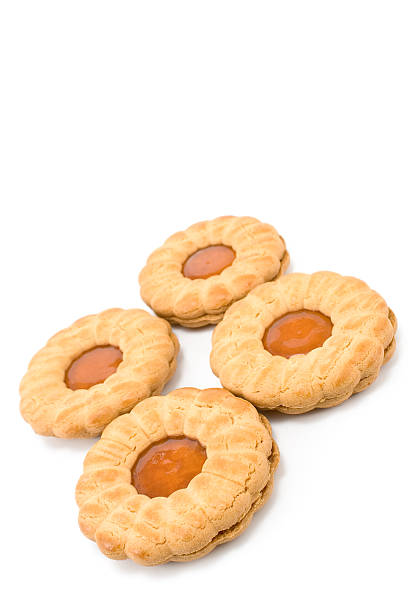 Cookies with apricot jam isolated on white stock photo