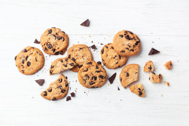 Cookies with chocolate chips. American cookies with chocolate chips on white wooden background. Top view. cookie stock pictures, royalty-free photos & images