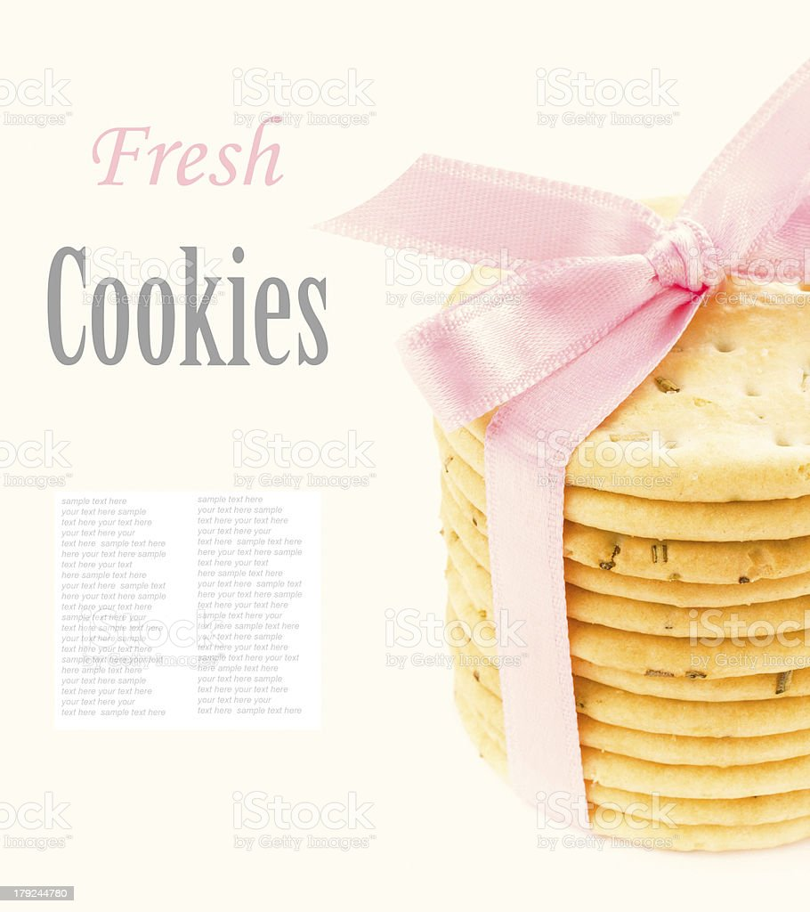 Cookies with pink ribbon isolated on white background, closeup royalty-free stock photo