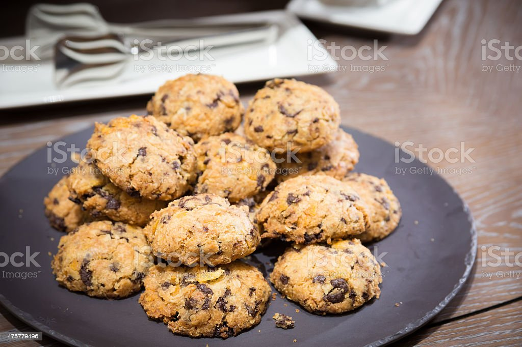 Cookies with raisins on wooden table stock photo