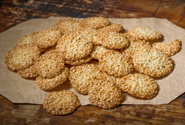 Cookies with sesame  on vintage wooden background stock photo