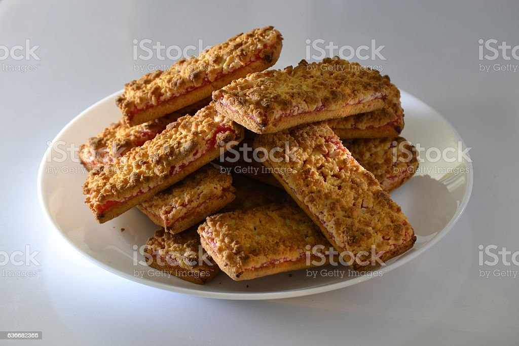 Cookies with strawberry jam on a white plate stock photo