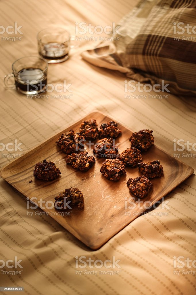 Cookies with the coffee on a wooden surface. royalty-free stock photo