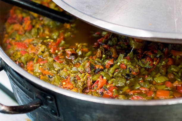 cooking a pot of chile - green chilli pepper stock photos and pictures