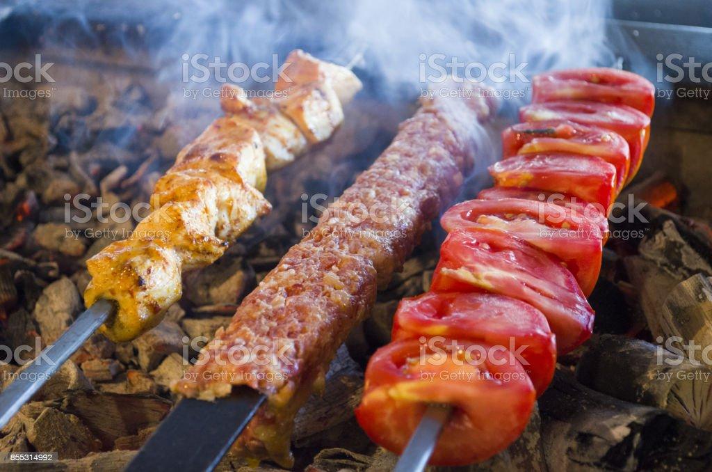 cooking adana kebabs on the restaurant stock photo