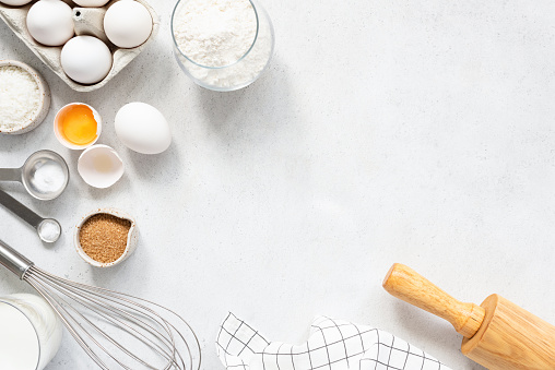 istock Cooking And Baking Ingredients Utensils On White Concrete Background 1171579778