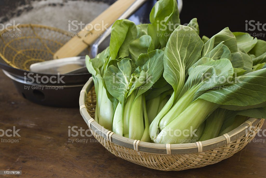Cooking and Preparing Chinese Bok Choy Vegetable in Kitchen stock photo