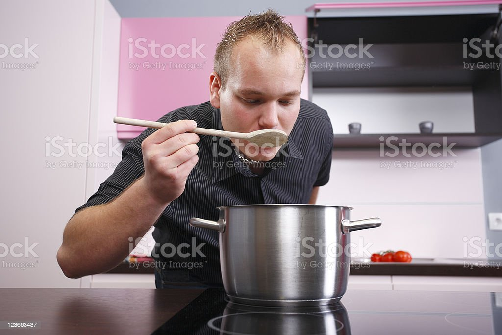 Cooking and tastaing royalty-free stock photo