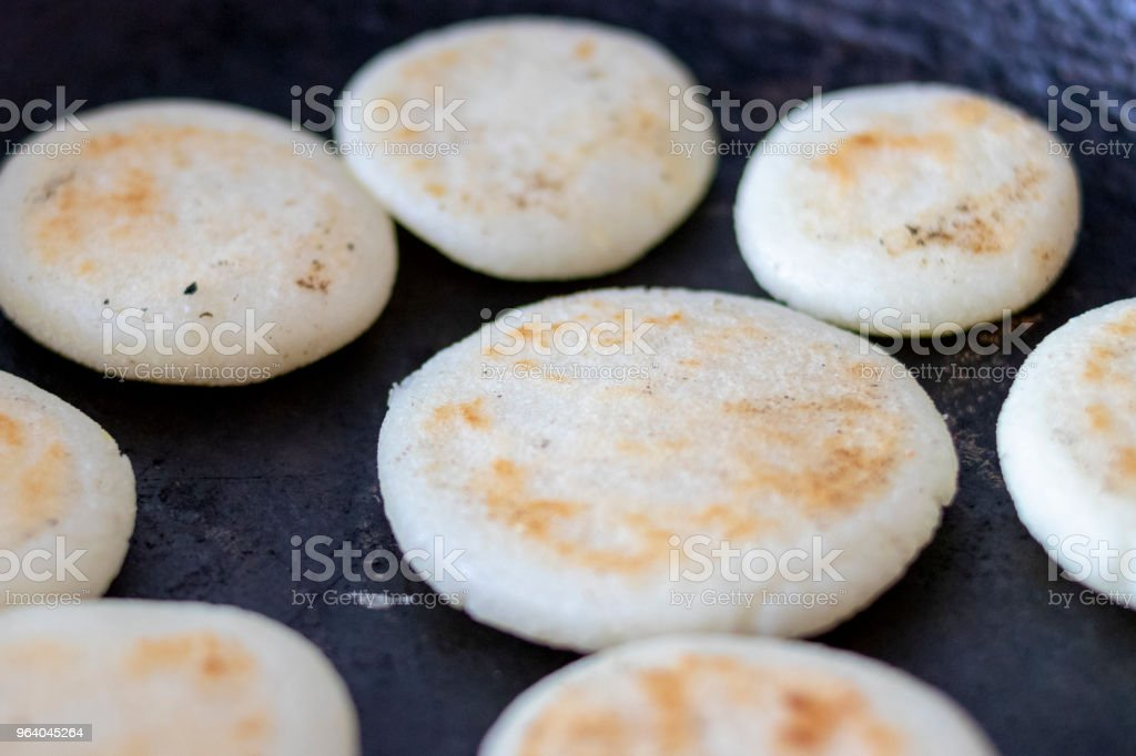 Cooking arepas in the pan - Royalty-free Arepa Stock Photo