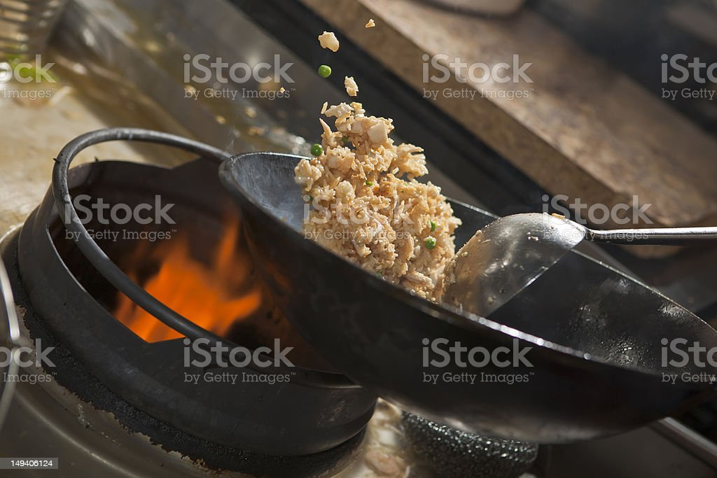 Cooking asian stir fry in wok stock photo