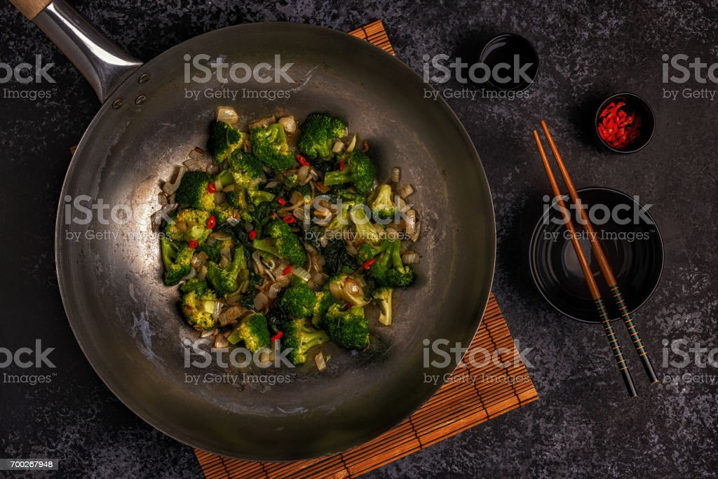 Cooking asian wok with stir fry vegetables stock photo