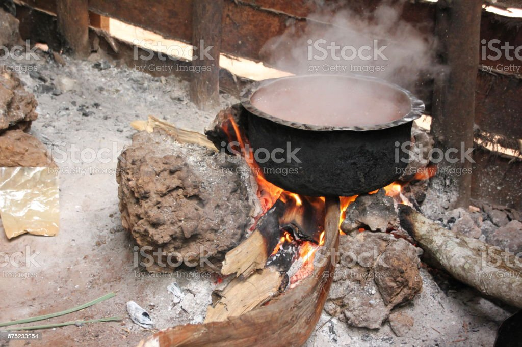 Cooking at a fireplace in Zanzibar, Tanzania, Indian Ocean, East Africa stock photo