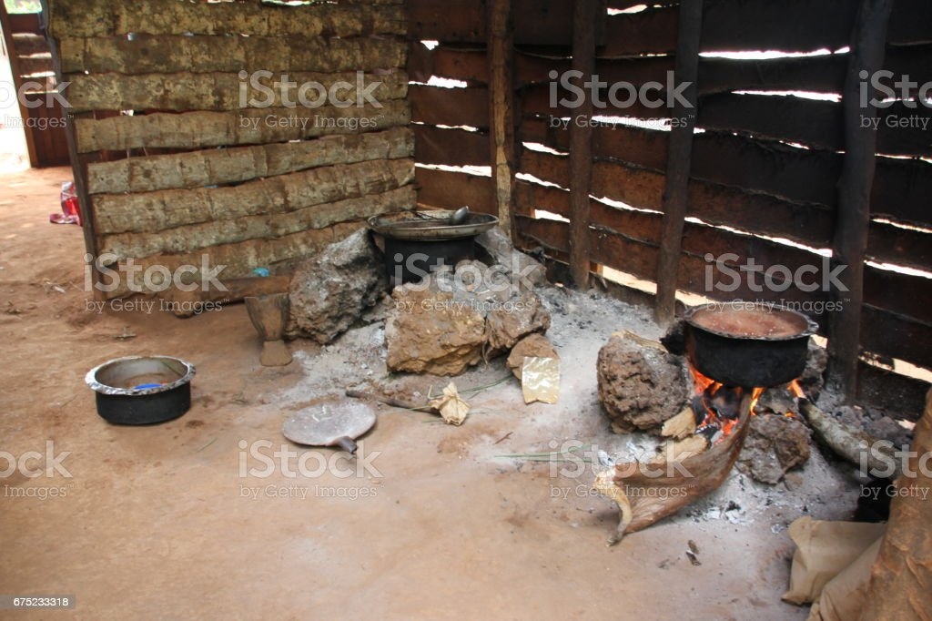 Cooking at a fireplace in Zanzibar, Tanzania, Indian Ocean, East Africa royalty-free stock photo