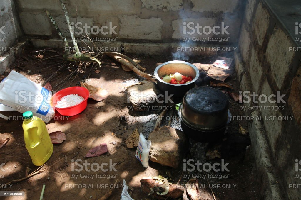 Cooking at fireplace in Zanzibar, Tanzania, Indian Ocean, East Africa stock photo