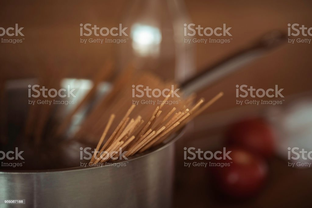 cooking at home, whole-grained italian pasta on wooden background, clean food, closeup, vegetarian healthy food, lifestyle stock photo