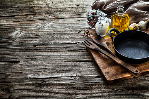 Cooking backgrounds: cooking ingredients and utensils on rustic wooden table with copy space