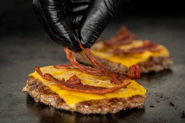 Cooking Bacon cheese burger Hand glove bacon cheeseburger stock pictures, royalty-free photos & images