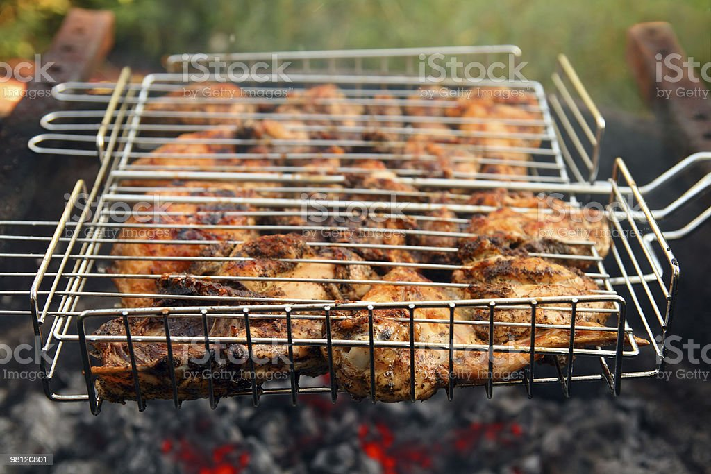 cooking barbecue on grill close-up royalty-free stock photo