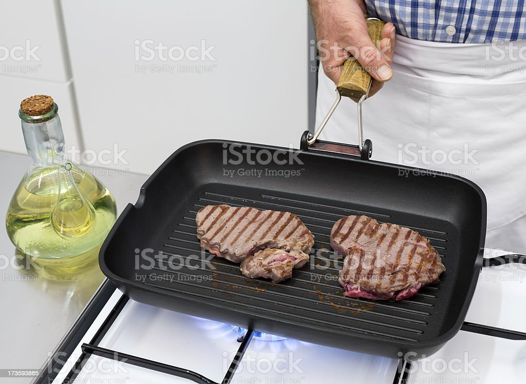 Cooking beef steak royalty-free stock photo