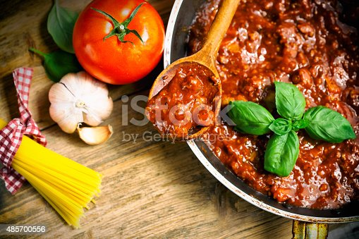 Spaghetti Bolognaise Sauce  in the Pot on the wooden table
