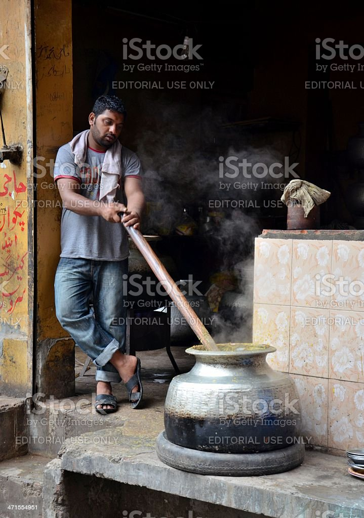 Cooking breakfast early morning Lahore Pakistan stock photo
