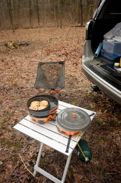 Cooking breakfast in car camping site stock photo