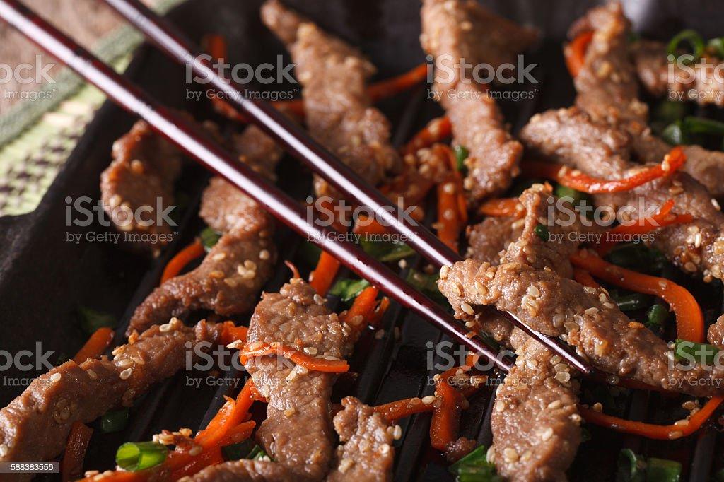 Cooking Bulgogi beef with carrot on the grill macro. horizontal stock photo
