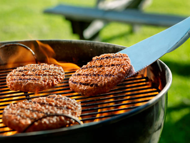 Cooking Burgers on a Backyard BBQ stock photo