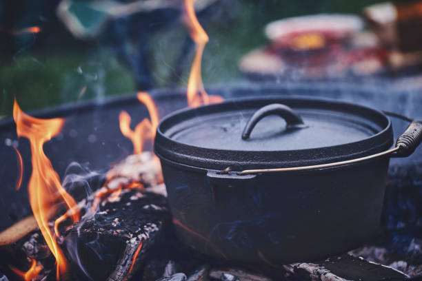 Cooking Chili Con Carne in Dutch Oven over Logfire stock photo